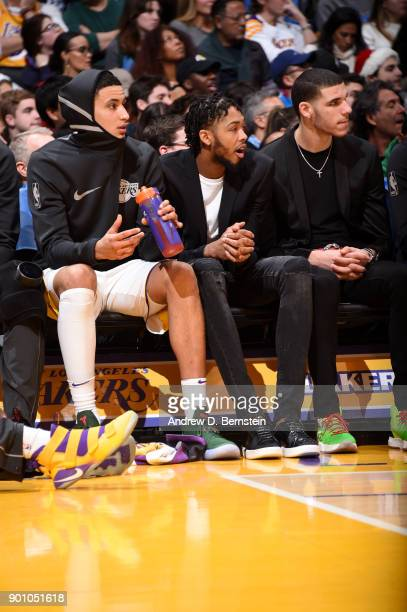 Kyle Kuzma Brandon Ingram and Lonzo Ball of the Los Angeles Lakers look on during the game against the Minnesota Timberwolves on December 25 2017 at...