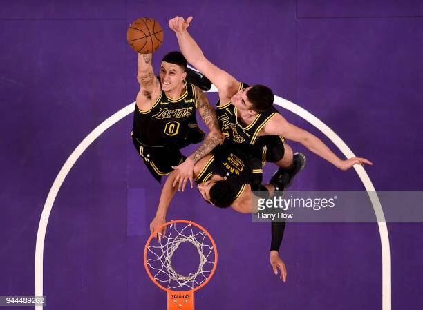 Kyle Kuzma Ivica Zubac and Josh Hart of the Los Angeles Lakers jump for a rebound during the game against the Milwaukee Bucks at Staples Center on...