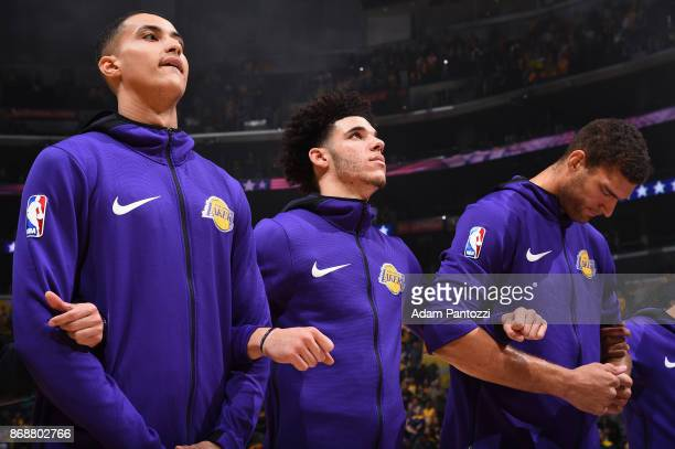Kyle Kuzma Lonzo Ball and Brook Lopez of the Los Angeles Lakers honor the National Anthem before the game against the Detroit Pistons on October 31...