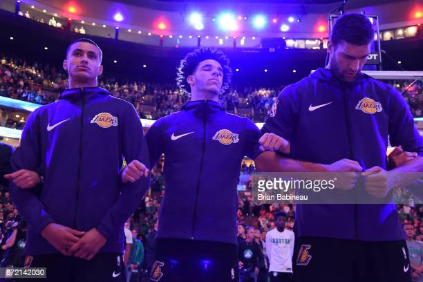 Kyle Kuzma Lonzo Ball and Brook Lopez of the Los Angeles Lakers stand on the court for the National Anthem before the game against the Boston Celtics...