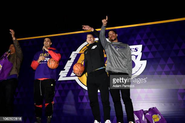 Kyle Kuzma Moritz Wagner and Josh Hart of the Los Angeles Lakers talks at the Thanksgiving dinner to guests from Los Angeles community organizations...