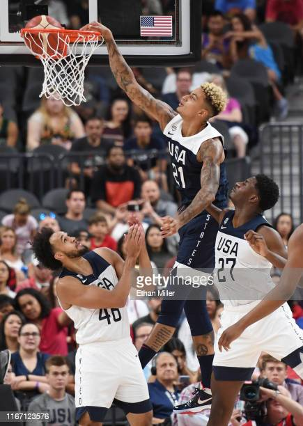 Kyle Kuzma of the 2019 USA Men's National Team dunks against Derrick White and Jaren Jackson Jr #27 of the 2019 USA Men's Select Team during the 2019...