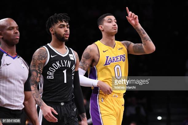 Kyle Kuzma of the Los Angeles Lakers and D'Angelo Russell of the Brooklyn Nets during the game at Barclays Center on February 2 2018 in Brooklyn New...