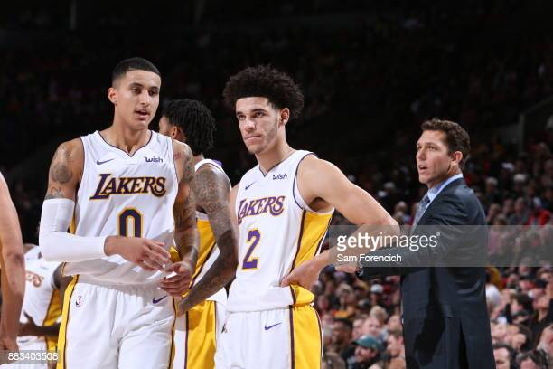 Kyle Kuzma of the Los Angeles Lakers and Lonzo Ball of the Los Angeles Lakers are seen on the court during the game against the Portland Trail...