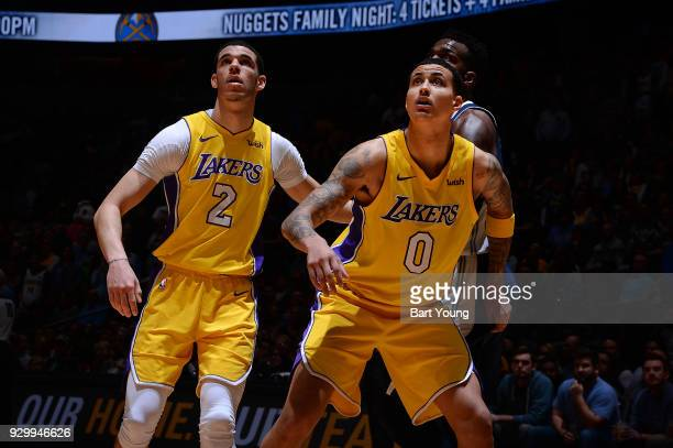 Kyle Kuzma of the Los Angeles Lakers and Lonzo Ball of the Los Angeles Lakers look on during the game against the Denver Nuggets on March 9 2018 at...