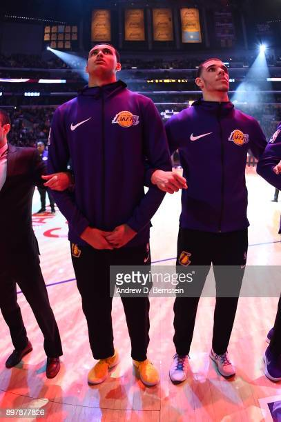 Kyle Kuzma of the Los Angeles Lakers and Lonzo Ball of the Los Angeles Lakers stand on the court during the National Anthem before the game against...
