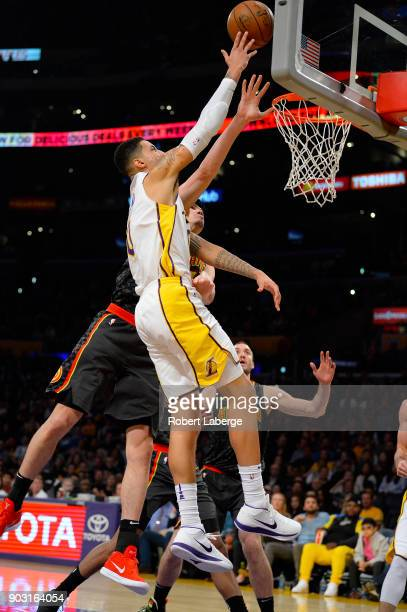 Kyle Kuzma of the Los Angeles Lakers attacks the basket against Ersan Ilyasova of the Atlanta Hawks on January 7 2018 at STAPLES Center in Los...