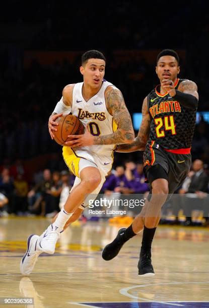 Kyle Kuzma of the Los Angeles Lakers attacks the basket against Kent Bazemore of the Atlanta Hawks on January 7 2018 at STAPLES Center in Los Angeles...