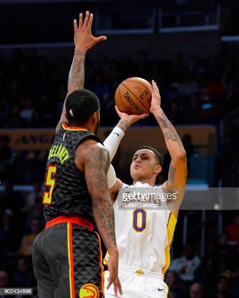 Kyle Kuzma of the Los Angeles Lakers attempts a jump shot against Malcolm Delaney of the Atlanta Hawks on January 7 2018 at STAPLES Center in Los...