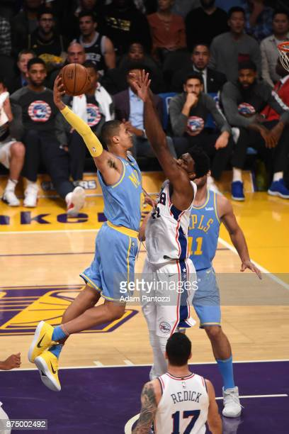 Kyle Kuzma of the Los Angeles Lakers attemts to dunk the ball over Joel Embiid of the Philadelphia 76ers on November 15 2017 at STAPLES Center in Los...