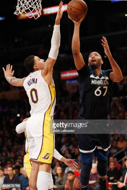 Kyle Kuzma of the Los Angeles Lakers blocks the shot from Taj Gibson of the Minnesota Timberwolves during the first half of the game at the Staples...