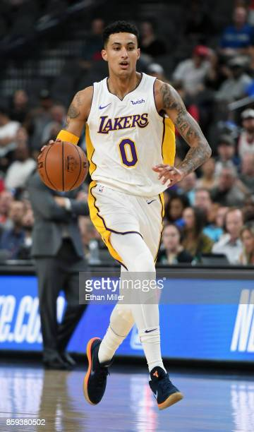 Kyle Kuzma of the Los Angeles Lakers brings the ball up the court against the Sacramento Kings during their preseason game at TMobile Arena on...
