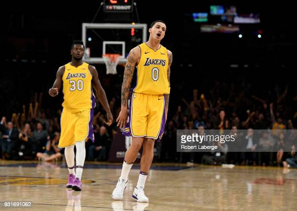 Kyle Kuzma of the Los Angeles Lakers celebrates a shot against the Denver Nuggets as his teamate Julius Randle looks on on March 13 2018 at STAPLES...