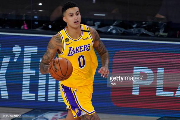 Kyle Kuzma of the Los Angeles Lakers controls the ball against the Toronto Raptors during the first half of an NBA basketball game at The Arena in...