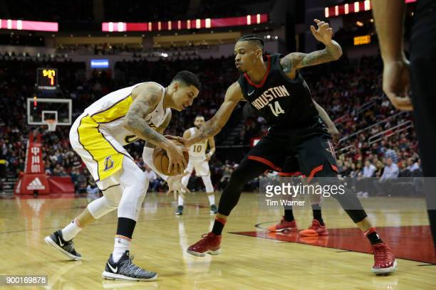 Kyle Kuzma of the Los Angeles Lakers controls the ball defended by Gerald Green of the Houston Rockets in the second half at Toyota Center on...