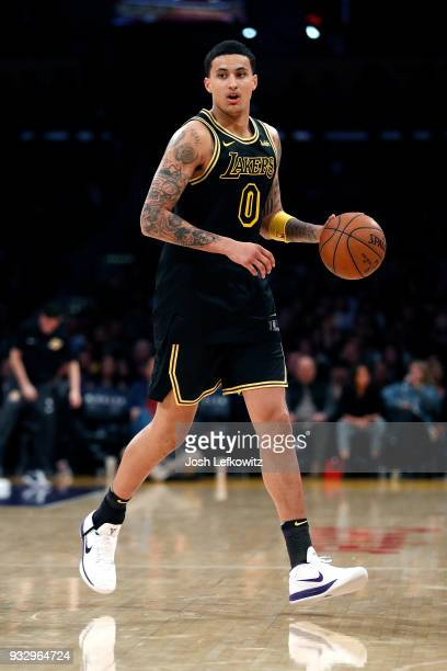 Kyle Kuzma of the Los Angeles Lakers controls the ball during the game against the Miami Heat at Staples Center on March 16 2018 in Los Angeles...