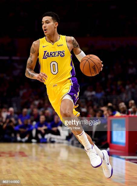 Kyle Kuzma of the Los Angeles Lakers dribbles during the game against the LA Clippers at Staples Center on October 10 2017 in Los Angeles California