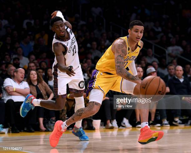 Kyle Kuzma of the Los Angeles Lakers dribbles past Caris LeVert of the Brooklyn Nets during a 104-102 Nets win at Staples Center on March 10, 2020 in...