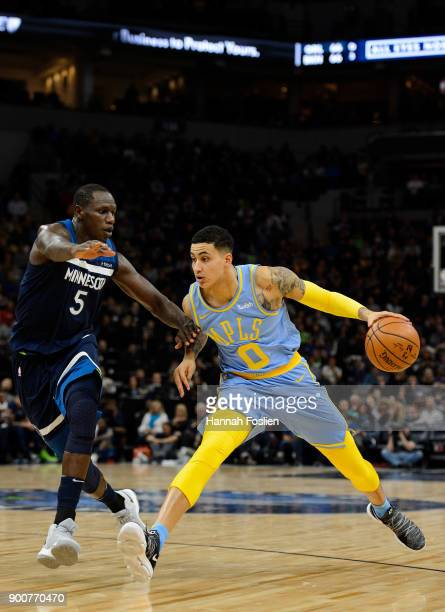 Kyle Kuzma of the Los Angeles Lakers dribbles the ball against Gorgui Dieng of the Minnesota Timberwolves during the game on January 1 2018 at the...