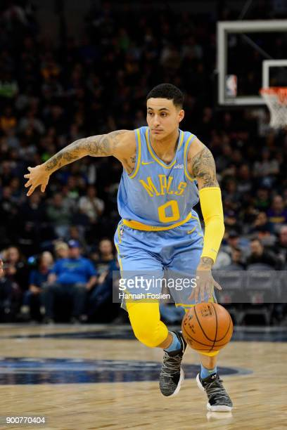 Kyle Kuzma of the Los Angeles Lakers dribbles the ball against the Minnesota Timberwolves during the game on January 1 2018 at the Target Center in...