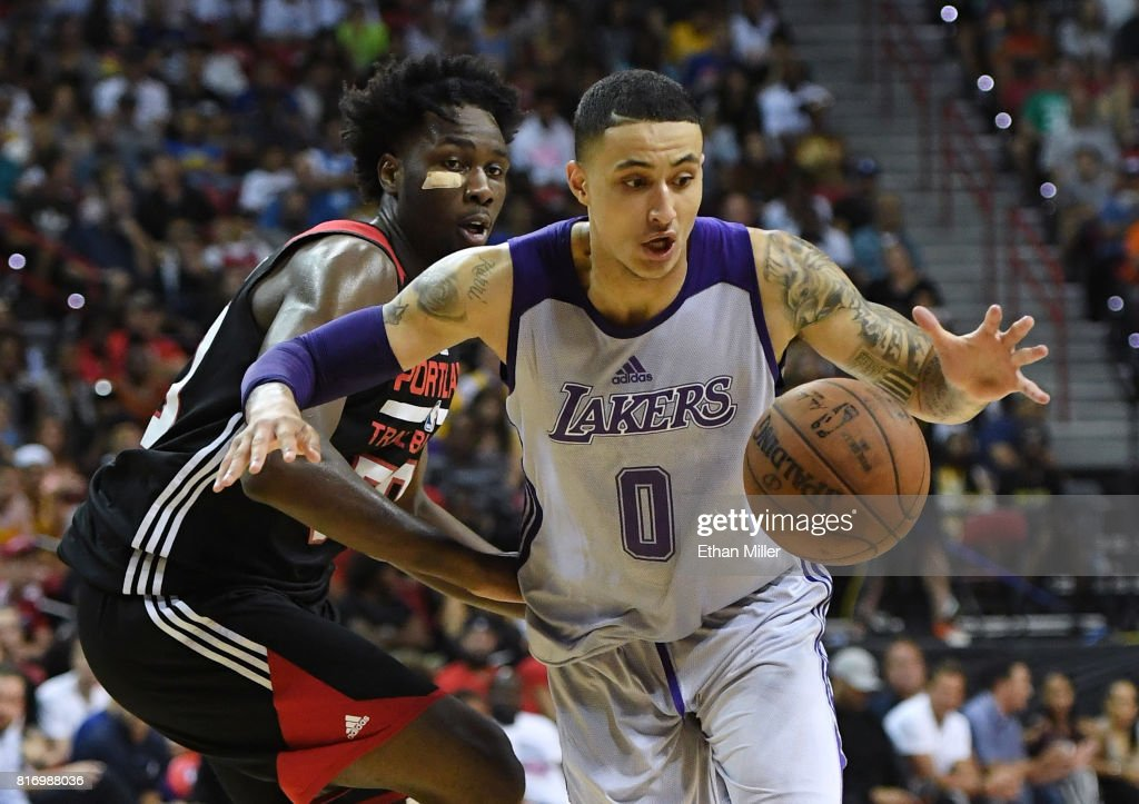 Kyle Kuzma #0 of the Los Angeles Lakers drives past Caleb Swanigan #50 of the Portland Trail Blazers during the championship game of the 2017 Summer League at the Thomas & Mack Center on July 17, 2017 in Las Vegas, Nevada. Los Angeles won 110-98.