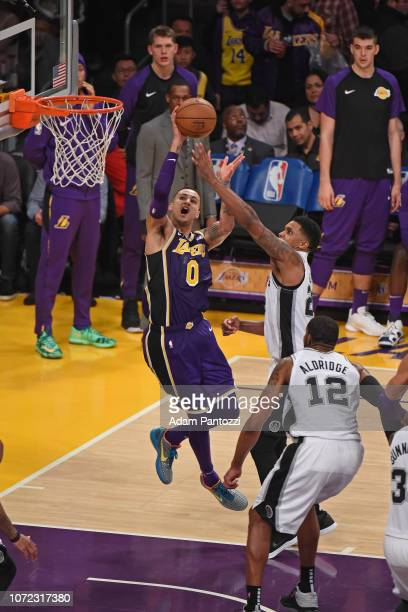Kyle Kuzma of the Los Angeles Lakers drives to the basket against the San Antonio Spurs on December 5 2018 at STAPLES Center in Los Angeles...