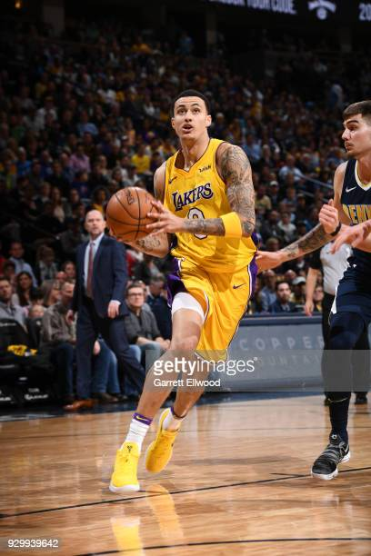 Kyle Kuzma of the Los Angeles Lakers drives to the basket against the Denver Nuggets on March 9 2018 at the Pepsi Center in Denver Colorado NOTE TO...