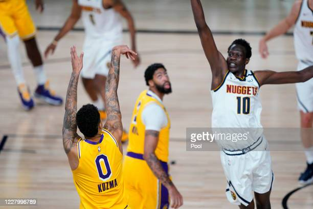 Kyle Kuzma of the Los Angeles Lakers follows through on his game-winning three-pointer over Bol Bol of the Denver Nuggets during the second half at...