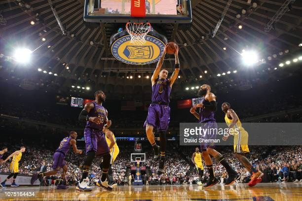 Kyle Kuzma of the Los Angeles Lakers gets the rebound against the Golden State Warriors on December 25 2018 at ORACLE Arena in Oakland California...