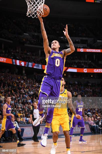 Kyle Kuzma of the Los Angeles Lakers goes to the basket against the Denver Nuggets on December 2 2017 at the Pepsi Center in Denver Colorado NOTE TO...