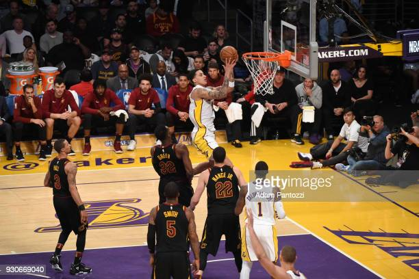 Kyle Kuzma of the Los Angeles Lakers goes to the basket against the Cleveland Cavaliers on March 11 2018 at STAPLES Center in Los Angeles California...