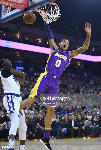 Kyle Kuzma of the Los Angeles Lakers goes up to shoot and gets fouled by Draymond Green of the Golden State Warriors during an NBA basketball game at...