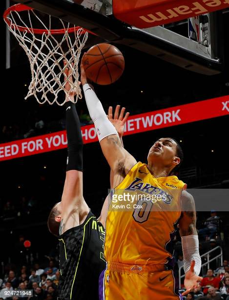 Kyle Kuzma of the Los Angeles Lakers grabs a rebound against Mike Muscala of the Atlanta Hawks at Philips Arena on February 26 2018 in Atlanta...