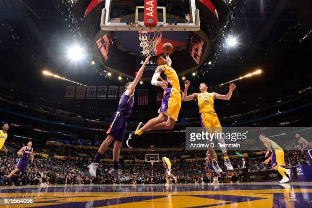 Kyle Kuzma of the Los Angeles Lakers grabs a rebound against the Phoenix Suns on November 17 2017 at STAPLES Center in Los Angeles California NOTE TO...