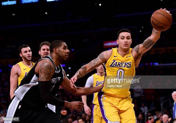 Kyle Kuzma of the Los Angeles Lakers grabs a rebound in front of LaMarcus Aldridge of the San Antonio Spurs during a 9381 Laker win at Staples Center...