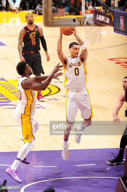 Kyle Kuzma of the Los Angeles Lakers grabs the rebound against the Cleveland Cavaliers on March 11 2018 at STAPLES Center in Los Angeles California...