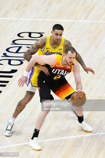 Kyle Kuzma of the Los Angeles Lakers guards Joe Ingles of the Utah Jazz during a game at Vivint Smart Home Arena on February 24, 2021 in Salt Lake...