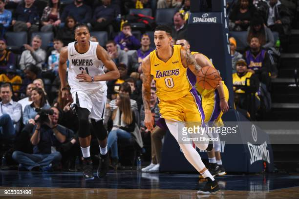 Kyle Kuzma of the Los Angeles Lakers handles the ball against Deyonta Davis of the Memphis Grizzlies on January 15 2018 at FedExForum in Memphis...