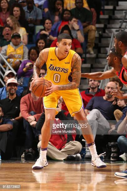 Kyle Kuzma of the Los Angeles Lakers handles the ball against the New Orleans Pelicans on February 14 2018 at the Smoothie King Center in New Orleans...