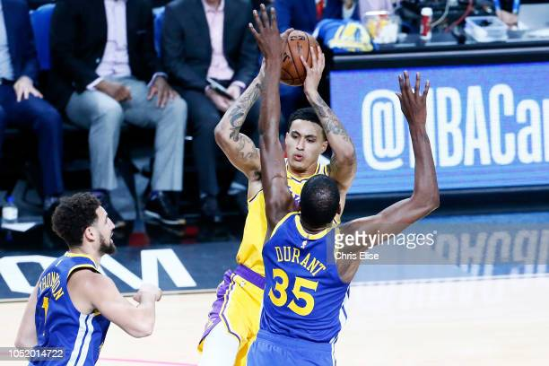 Kyle Kuzma of the Los Angeles Lakers handles the ball against the Golden State Warriors during the game on October 10 2018 at TMobile Arena in Las...