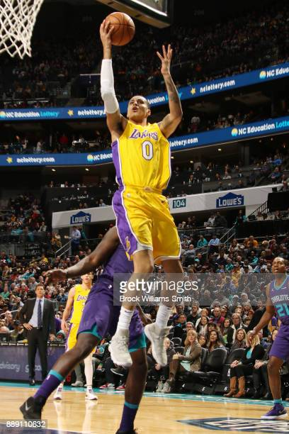 Kyle Kuzma of the Los Angeles Lakers handles the ball against the Charlotte Hornets on December 9 2017 at Spectrum Center in Charlotte North Carolina...