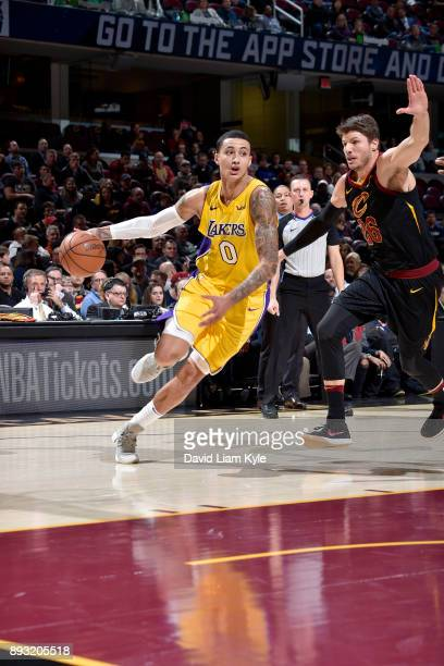 Kyle Kuzma of the Los Angeles Lakers handles the ball against the Cleveland Cavaliers on December 14 2017 at Quicken Loans Arena in Cleveland Ohio...