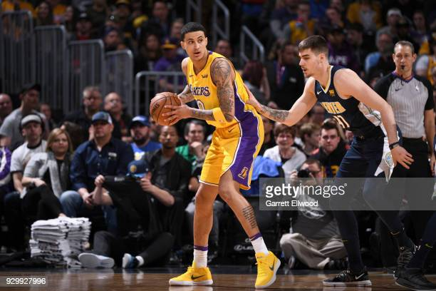 Kyle Kuzma of the Los Angeles Lakers handles the ball against the Denver Nuggets on March 9 2018 at the Pepsi Center in Denver Colorado NOTE TO USER...