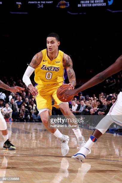 Kyle Kuzma of the Los Angeles Lakers handles the ball during the game against the New York Knicks on December 12 2017 at Madison Square Garden in New...