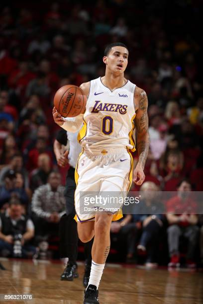 Kyle Kuzma of the Los Angeles Lakers handles the ball during the game against the Houston Rockets on December 20 2017 at Toyota Center in Houston...