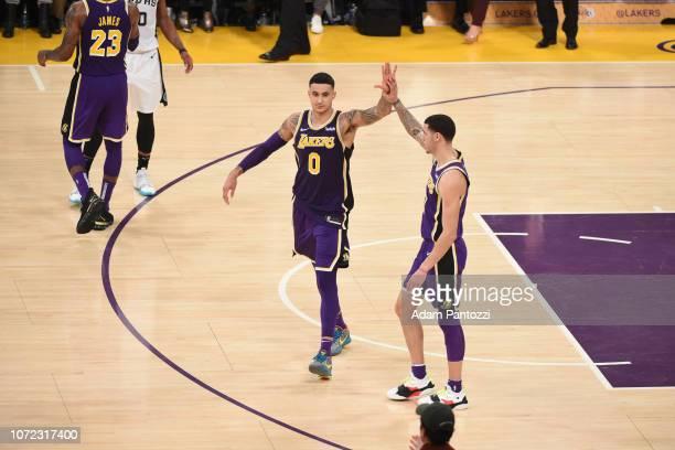 Kyle Kuzma of the Los Angeles Lakers highfives Lonzo Ball of the Los Angeles Lakers against the San Antonio Spurs on December 5 2018 at STAPLES...