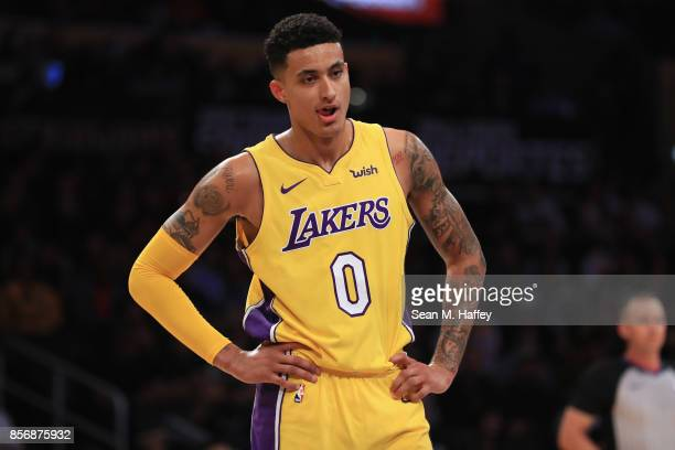 Kyle Kuzma of the Los Angeles Lakers looks on during the first half of a preseason game against the Denver Nuggets at Staples Center on October 2...
