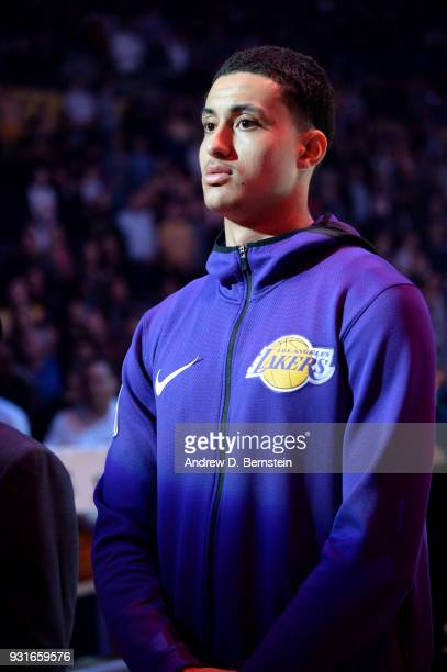 Kyle Kuzma of the Los Angeles Lakers looks on during the national anthem prior to the game against the Denver Nuggets on March 13 2018 at STAPLES...