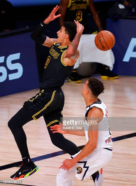 Kyle Kuzma of the Los Angeles Lakers looses the ball as he drives to the basket against Michael Porter Jr. #1 of the Denver Nuggets during the second...