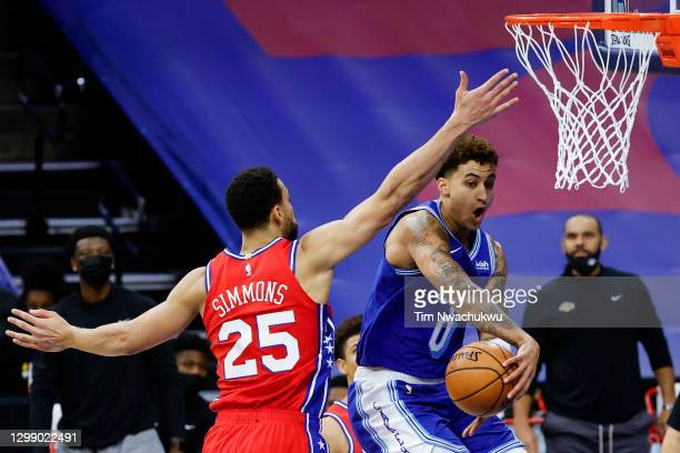 Kyle Kuzma of the Los Angeles Lakers passes past Ben Simmons of the Philadelphia 76ers during the first quarter at Wells Fargo Center on January 27,...